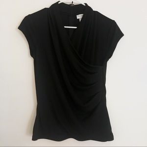 Classy black V-neck top with flattering trim.
